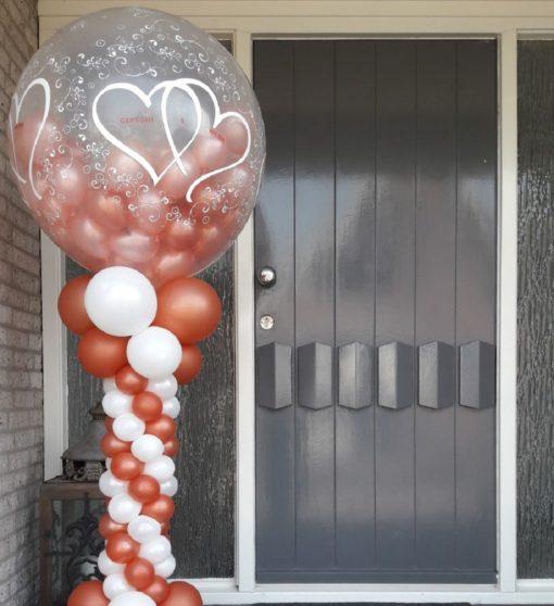Spiraalpilaar met gevulde topballon